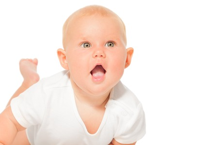 babygro: Portrait of baby with open mouth in white bodysuit Stock Photo