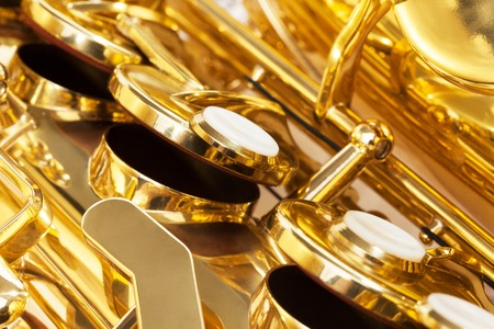 closeup view: Shiny golden keys of alto saxophone close-up view