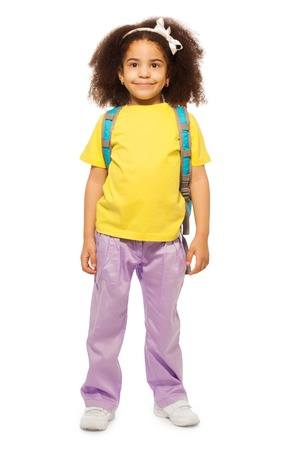 kids wear: Full length view of smiling African girl wearing rucksack and standing on the white background Stock Photo