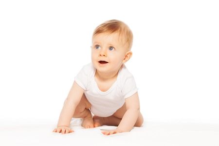 babygro: Looking amazed cute little baby wearing white bodysuit on the white background alone