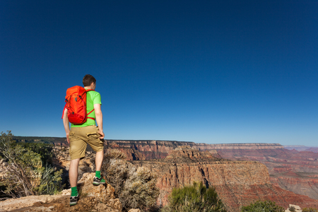 Man with backpack standing in Grand Canyon National Park, USA during summer day