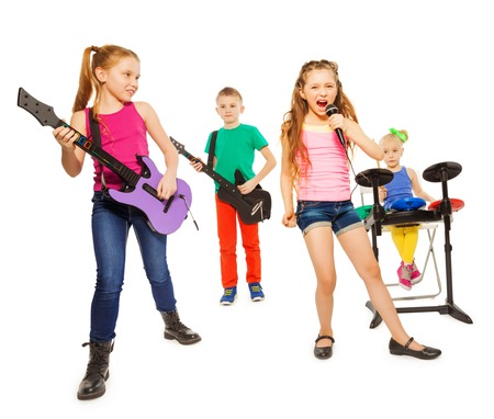 Cool kids playing on musical instruments as rock group and girl singing as vocalist in front on white background