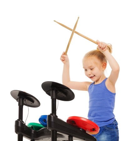 Happy blond girl playing with drumsticks on cymbals on white background Imagens