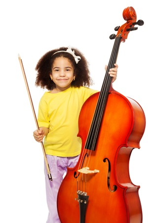 fiddlestick: African girl holding cello with fiddlestick ready to play standing on the white background