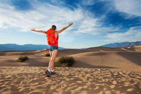 hot day: Girl with straight arms standing in Death valley view during hot summer day in USA