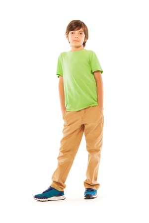 full height: Full height portrait of the nice Caucasian boy stand isolated on white