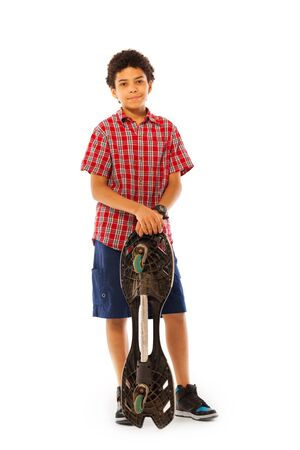 boy skater: Nice school age African black boy standing with skate board in full height isolated on white