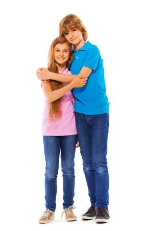 full height: Nice lovely two siblings twins boy and girl hug together full height portrait on white Stock Photo