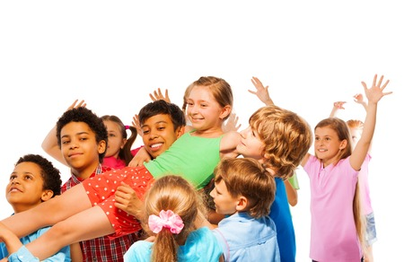 children hands: Croup of kids carry smiling and laughing girl on hands smile and running
