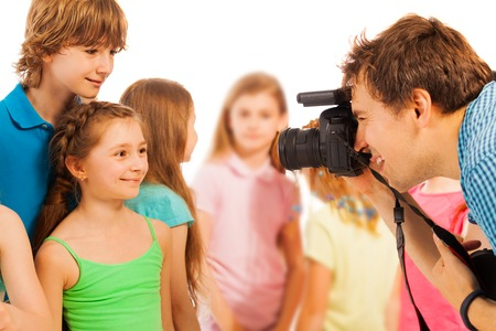 beautiful boys: Adult photographer photographing beautiful kids boys and girls with dslr camera