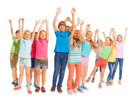 lift hands: Many happy kids standing in together and lift hands up in the air Stock Photo