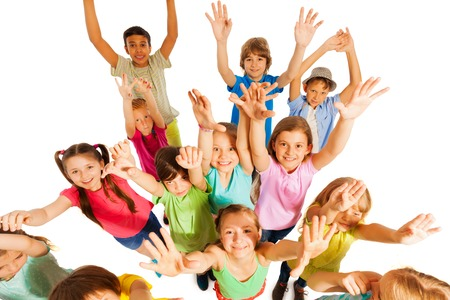 Funny bunch of kids jumping and lifting hands in the air cheering and screaming isolated on white Archivio Fotografico