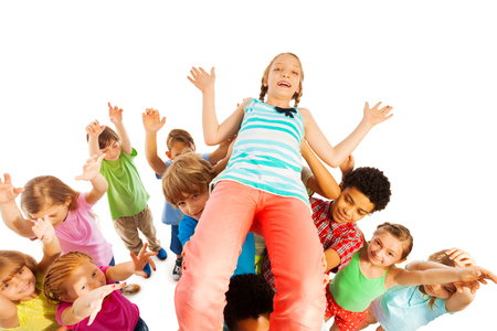 group shot: Funny group shot of kids carrying girl who won game, cheering and smiling isolated on white