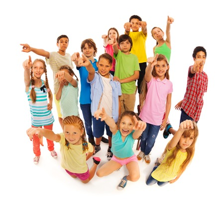 Bunch of diverse cute kids isolated on white standing and pointing at camera
