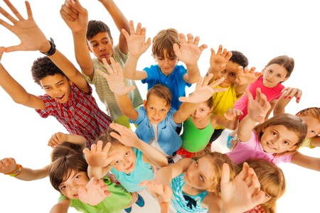 Large group of kids together view from above raise and stretch hands up in a crowd Stock Photo