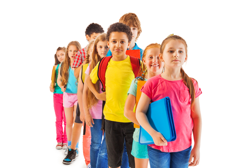 waiting in line: Front view of the line of boys and girls standing in a queue African black and Caucasian Stock Photo