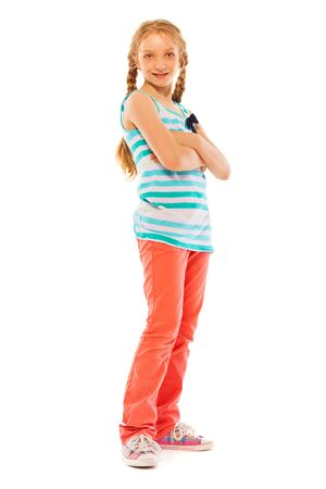 full height: Full height portrait of a confident school age girl standing over white background and smile