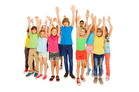 full height: Many kids standing together as big group with lifted hands isolated on white full height portraits