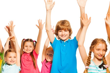 lifted hands: Boy and girls happy standing with lifted hands isolated on white, smiling and nice