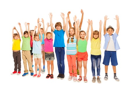rise: Very big group of kids standing together and rise hands up in the air isolated on white