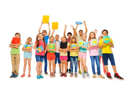 hand school education: Large group of school kid standing with notebooks in fool body length smiling wearing colorful t-shirts