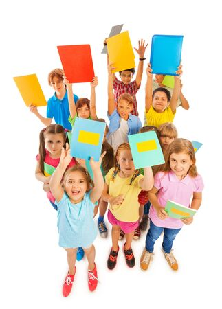 eight years old: Eight years old funny kids lifting textbooks and cheering Stock Photo