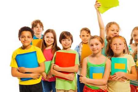 classmates: Happy group of classmates standing together with textbooks smiling isolated on white Stock Photo
