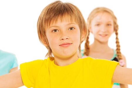 school age boy: Portrait of nice young school age boy over white in yellow t-shirt