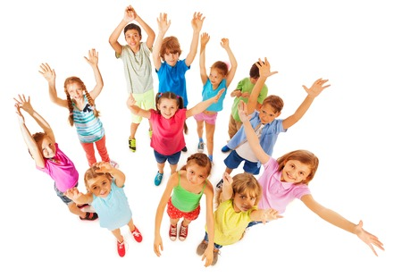 hands lifted up: Bunch of 8 years old kids standing with lifted hands up and smiling isolated on white Stock Photo