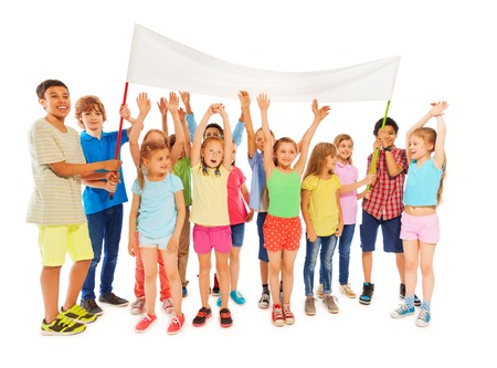 full height: Very large group of happy kids hold empty white banner standing isolated on white full height composition Stock Photo