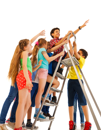 friendly competition: Fun friendly fight over the top of ladder in concept of leadership competition Stock Photo
