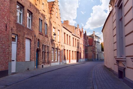 pave: European street with cobblestone pave, view during summer in Bruges, Belgium