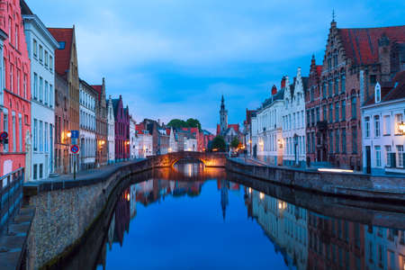 Dijver Spiegelrei street from the canal during evening, Bruges, Belgium Stock Photo
