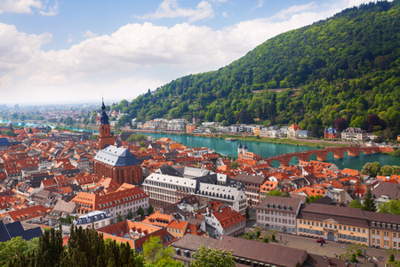 alte: Bright panorama view with Heiliggeistkirche church, Alte Brucke during summer in Heidelberg, Germany
