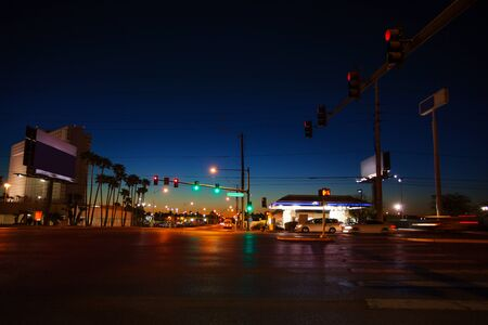 road traffic: Night view of the asphalt road and traffic lights in Las Vegas, Nevada, USA Stock Photo