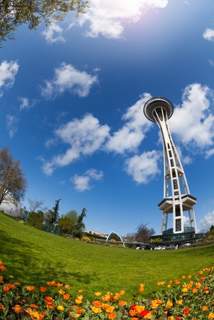 space needle: Space needle tower view with beautiful orange tulips in Seattle, Washington USA