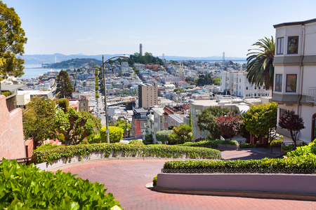 francisco: View of Lombard street with cityscape during summer sunny day, San Francisco, USA Stock Photo