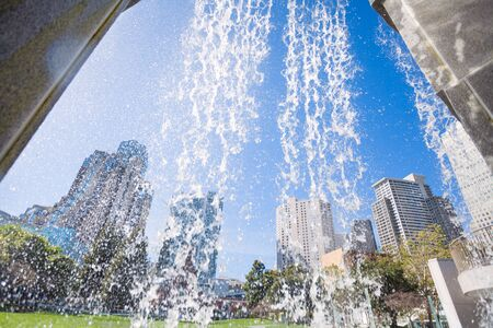 waterfall in the city: Waterfall fountain in Yerba Buena Gardens park during sunny day in San Francisco, United States