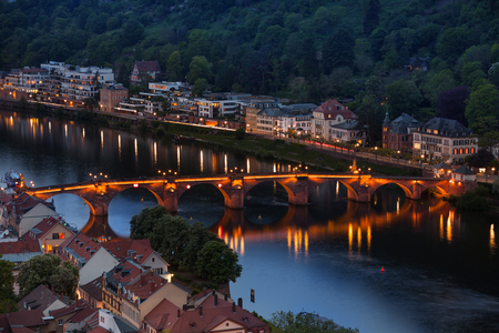 alte: Night panorama view of Alte Brucke bridge with lights and Heidelberg cityscape in Germany