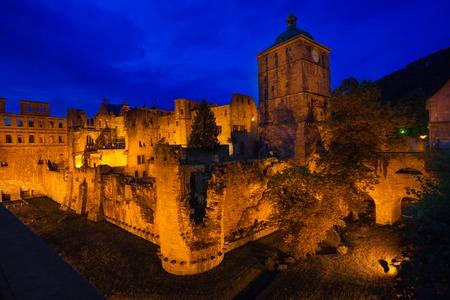 Schloss Heidelberg with golden lights during night in Heidelberg, Germany