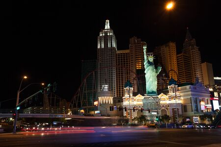 sin city: Las Vegas, United States - March 27, 2015:  New York Hotel and Casino from Tropicana Ave night photo with accent on liberty statue
