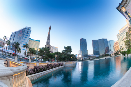 bellagio: Las Vegas, United States - March 27, 2015: Eiffel Tower and Planet Hollywood Resort hotels from Bellagio fountains pond Editorial