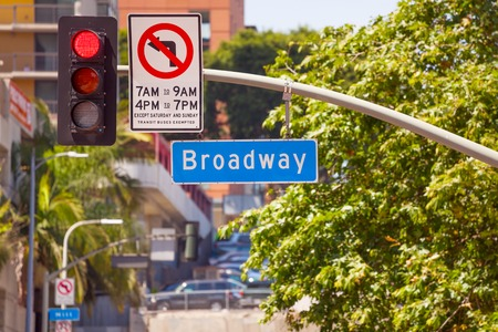 trafficlight: Red street light and Broadway sign on Los Angeles roads in LA, USA Stock Photo