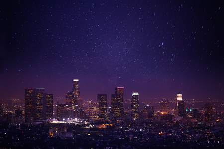 Beautiful night cityscape view of Los Angeles from Griffith Observatory with lights and shine of stars in the USA
