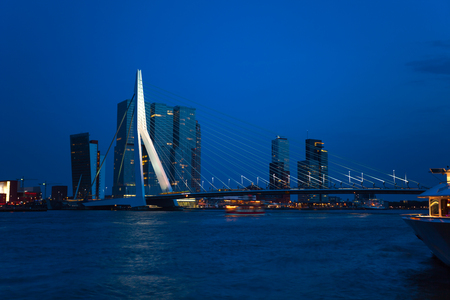 maas: Erasmusbrug bridge view at night in Rotterdam, Netherlands