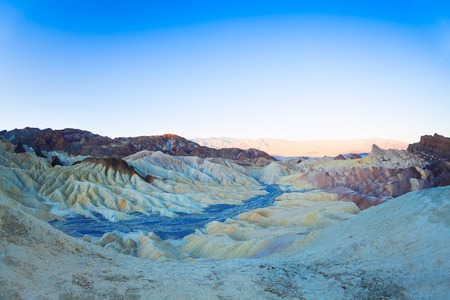 point of view: Mountain panorama of cream like patterns from Zabriskie Point View Death valley in the morning lights, California