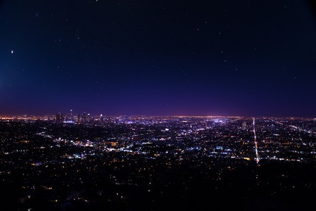 Beautiful cityscape view of Los Angeles at night from Griffith Observatory with lights and shine of stars in the USA