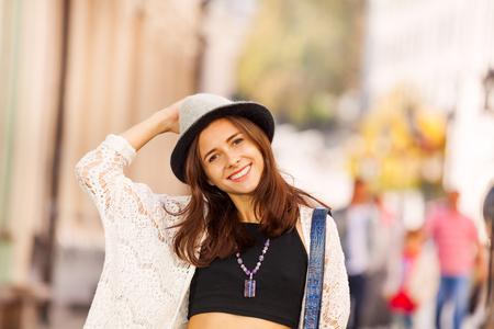 Portrait of girl with hat on the street during summer vacation time in Europe