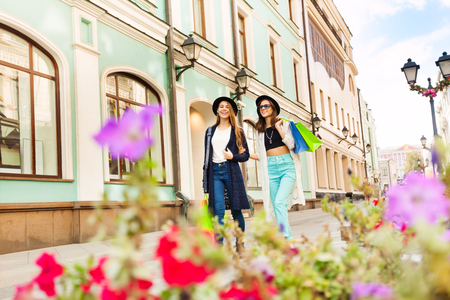 Young women shopping and carry bags during travelling in Europe during summer day time