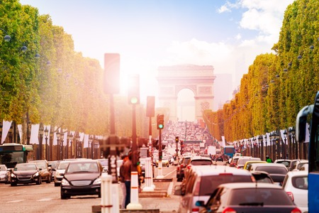 Traffic jam on the way toward Triumphal arc in Paris at the sunny autumn day